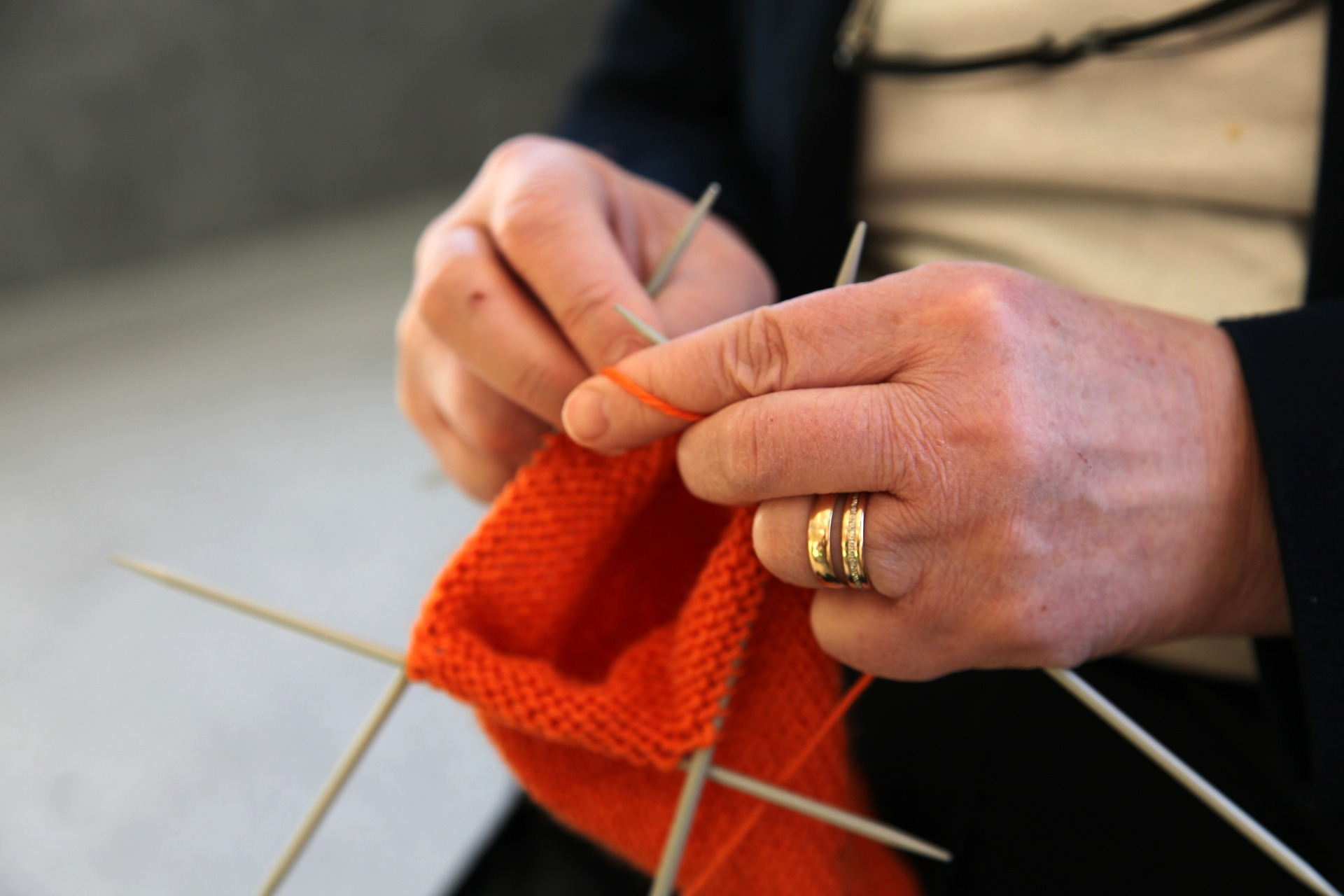senior hands knitting