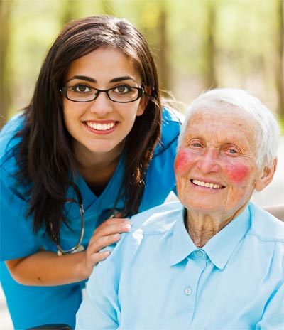 Daughter and happy elderly patient together outdoors.