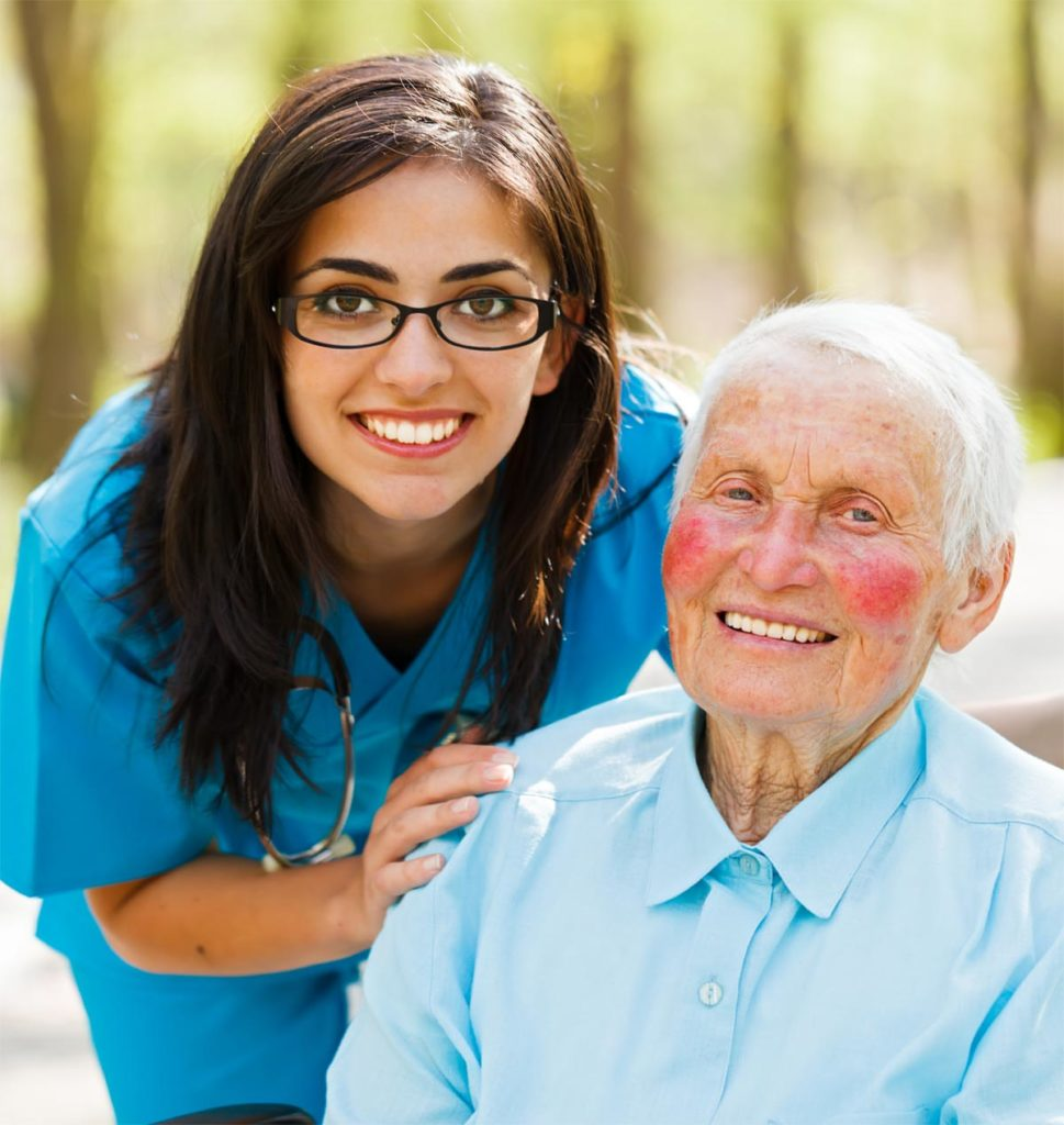 Kind nurse and happy elderly patient together outdoors.