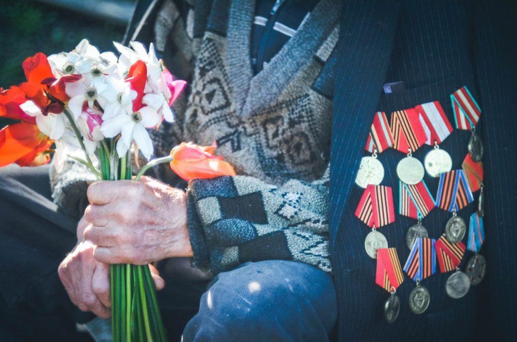 veteran holding flowers