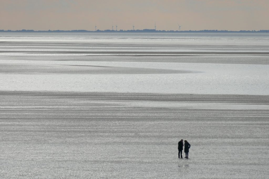 two people talking at the beach