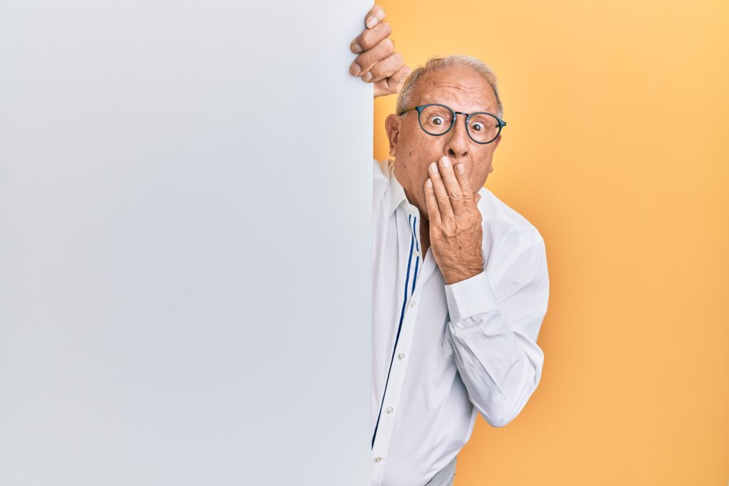 man peeking around wall